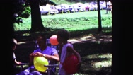 1971: kids playing with balloons at family summer reunion OMAHA, NEBRASKA Stock Footage