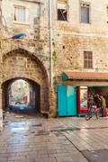 ACRE, ISRAEL - FEBRUARY 18, 2013: Sellers near street shops in old city Stock Photos