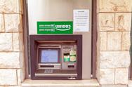 JERUSALEM, ISRAEL - FEBRUARY 19, 2013:ATM on a city street Stock Photos
