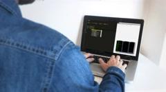 Man Coding On Notebook, Shot Behind Model Shoulder Stock Footage