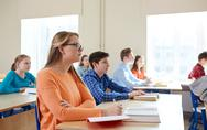 Group of students with books at school lesson Stock Photos