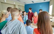 Group of students and teacher at school classroom Stock Photos