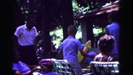 1971: sitting in outdoor fold up lounge chairs at family reunion OMAHA, NEBRASKA Stock Footage