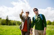 Happy couple with backpacks hiking outdoors Stock Photos