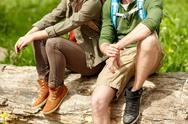 Close up of couple resting on tree trunk outdoors Stock Photos