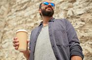 Close up of man with paper coffee cup on street Stock Photos