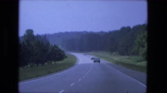1976: highway driving out of town into green forest rural area FORT WAYNE Stock Footage