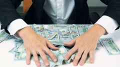 Hands collecting money together Stock Footage