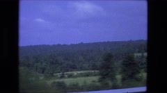 1976: driving over natural landscape area green forested wooded zone FORT WAYNE Stock Footage