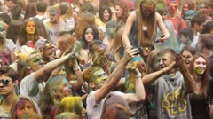 Young people having fun at the event Big Pillows Battle and Holi paints festival Stock Footage