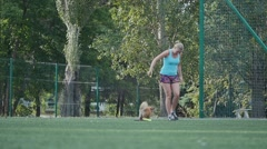 Girl with a trained dog Stock Footage