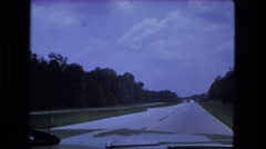 1976: driving fast on new divided highway hilly rural wooded forest FORT WAYNE Stock Footage