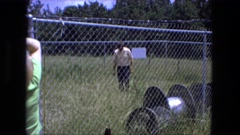 1976: grassland having car tracks is seen FORT WAYNE, INDIANA Stock Footage