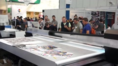 People attend international exhibition in Expo Center Stock Footage