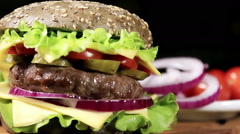 Beef burger meal on a bun with squid ink Stock Footage