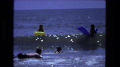 1976: people playing in the water on plastic floatation devices. FORT WAYNE Stock Footage