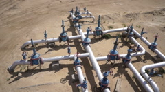 Aerial view of a oil and gas equipment,valves and pipelines Stock Footage