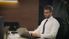 Young businessman asleep in the office at the computer Stock Footage
