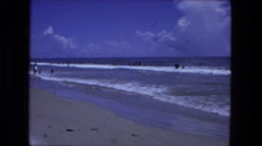 1976: beach and ocean on summer day FORT WAYNE, INDIANA Stock Footage