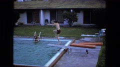 1976: boy jumping doing flip off of swimming pool diving board FORT WAYNE Stock Footage