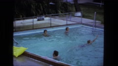 1976: people having a good time at swimming pool  Stock Footage