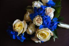 Wedding accessories. Boutonniere, Golden rings, a beautiful bouquet of flowers Stock Photos