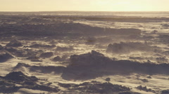 Slow motion - clouds of blowing snow over drifted sea ice Stock Footage
