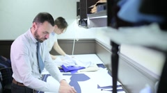 Male tailors working with sketches Stock Footage