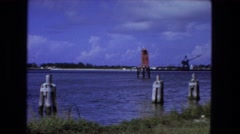 1976: harbor dock industrial area leading to the local hotel. FORT WAYNE Stock Footage