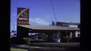 1976: motel somewhere nice with palm trees FORT WAYNE, INDIANA Stock Footage