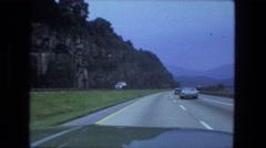 1976: big rock roadcut along new interstate highway, driving Stock Footage