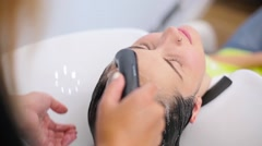 A girl wash her hair in a hairdressing salon Stock Footage