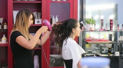 Drying girl's hair in a hairdressing salon Stock Footage