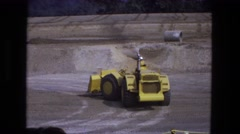 1976: caterpillar yellow bulldozer earth mover industrial vehicle driving around Stock Footage
