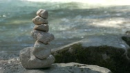 4K Zen rock stacking balancing Berchtesgaden National Park Ramsau Zauberwald Stock Footage