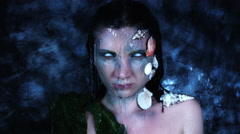 4k Halloween Shot of a Horror Woman Mermaid and Water Pouring on her Head Stock Footage