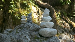 4K Zen rock stacking balancing Berchtesgaden National Park Ramsau Zauberwald Stock Footage