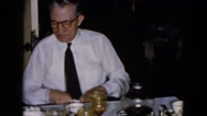 1957: an older couple sitting at table having coffee HICKSVILLE, NEW YORK Stock Footage
