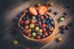 Berries on Wooden Background. Organic food. Stock Photos
