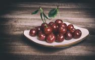 Fresh cherries on wooden table. Stock Photos