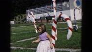 1957: little girls hugs and play around christmas stick. HICKSVILLE, NEW YORK Stock Footage