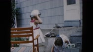 1957: little girls play with kitchen tools in the backyard HICKSVILLE, NEW YORK Stock Footage