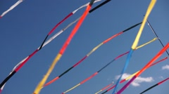 Multi color ribbon flags fluttering Stock Footage