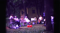 1971: family gathered in park for picnic OMAHA, NEBRASKA Stock Footage