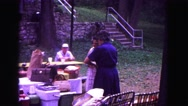 1971: two woman outdoors preparing family picnic OMAHA, NEBRASKA Stock Footage