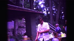 1971: family reunion man walking rolling up shirt sleeves OMAHA, NEBRASKA Stock Footage