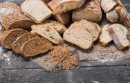 Bakery concept. Plenty of sliced bread background Stock Photos