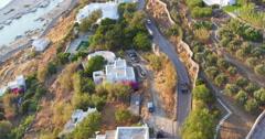 Aerial convertible car driving on island road mykonos greece 4K Stock Footage