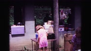 1971: child getting camera for her mother OMAHA, NEBRASKA Stock Footage