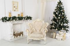 Decorated chrismas room with a tree,fireplace, armchair Stock Photos